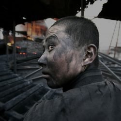 Lu-Guang-A-factory-worker-in-Wuhai-City-Inner-Mongolia-in-2005.-Due-to-a-lack-of-environmental-safety-standards-they-would-get-ill-after-one-or-two-years-on-the-job.